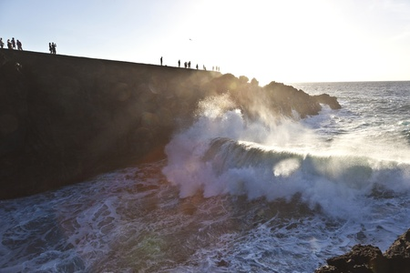 los hervideros: people watch the sunset at cliffs Los Hervideros in Lanzarote Stock Photo