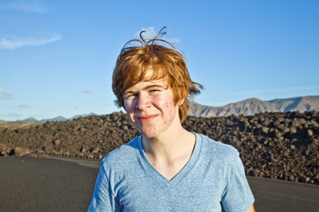 attractive young smiling  man in volcanic area photo