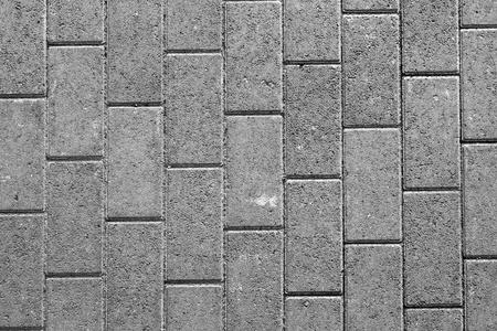 road paving: adoquines grises en la puesta del sol Foto de archivo