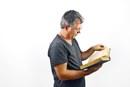 constitutional law: man with glasses reading in a book Stock Photo