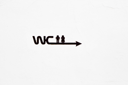 sign WC with icon of Man and woman on the concrete wall photo