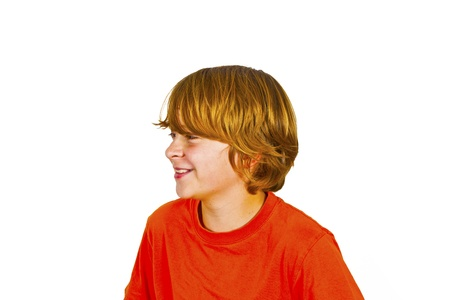 happy boy in Studio shaking his head  isolated on white photo