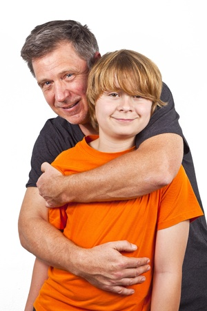 father and happy son hugging photo