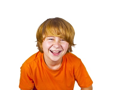 isoladed: young smart boy has fun posing in studio