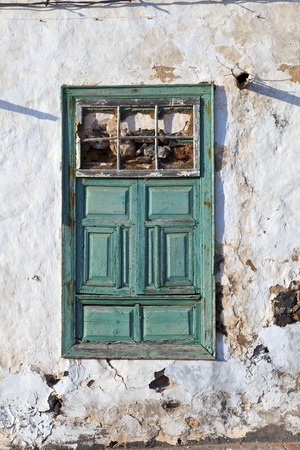 old typical chalked house wall with window and door Stock Photo - 12245858