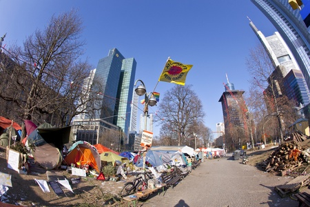 occupy wall street: FRANKFURT - FEB 12: The protest camp of the Occupy Frankfurt movement at the European Central Bank on February 12, 2011 in Frankfurt, Germany. It is part of the global Occupy Wall Street movement. Editorial