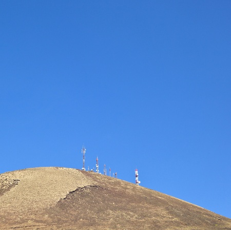 Radio telecommunications tower on top of an old volcano in Lanzarote, Spain photo