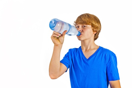 thirsty boy is drinking water photo