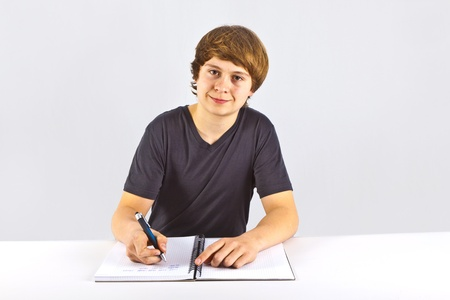 cute pupil doing homework for school photo
