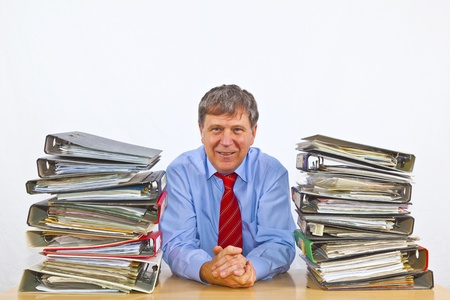 proble: man studies folder with files at his desk in the office