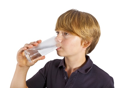 boy drinking water out of a glass photo