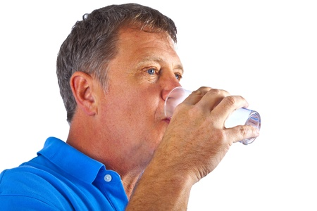 man drinking water out of a glass photo