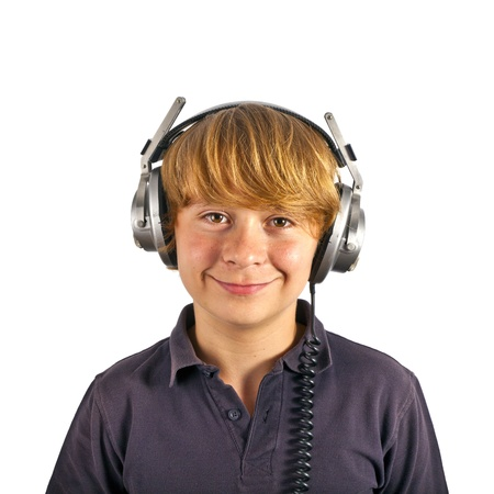 boy enjoys listening to music with headphones photo
