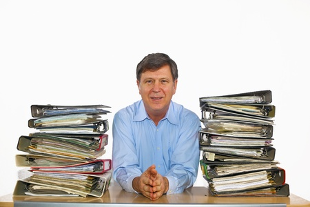 man studies folder with files at his desk in the office photo