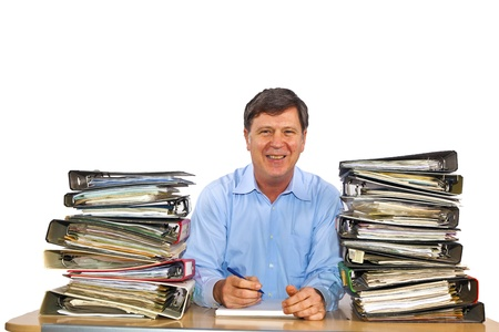 man studies folder with files at his desk in the office Stock Photo - 12600968