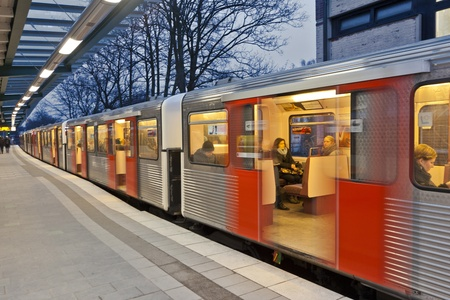 turnouts: HAMBURG, GERMANY - JANUARY 19: people inside the train direction airport  at January 19, 2011, Hamburg, Germany. The new airport line was inaugurated in 2008.