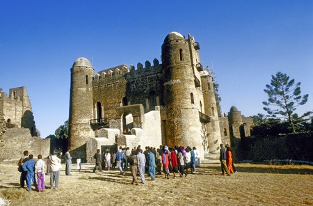 crenellated: GONDAR, ETHIOPIA - MAY 07: people love to marry at this ancient place  on May 07,1998 in Gondar, Ethiopia. King Fasil  settled in Gondar and established it as a permanent capital in 1636. Editorial