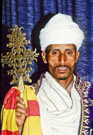 AXUM, ETHIOPIA - MAY 07: coptic priest in Ethiopia in his church on May 07,1998 in AXUM, Ethiopia.The Coptic Church is based on the teachings of Saint Mark from the year 200 A.D. during reign of Nero. Stock Photo - 12465803