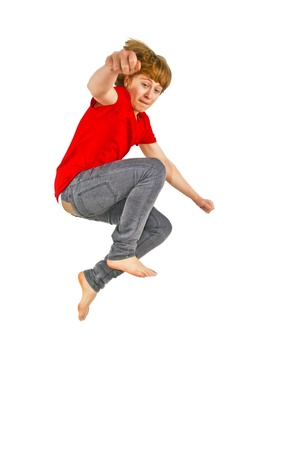 red jeans: Portrait Of Teenage Boy Jumping In The Air Stock Photo