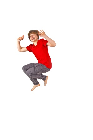 Portrait Of Teenage Boy Jumping In The Air photo