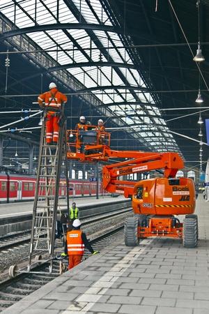 catenation: WIESBADEN, GERMANY. worker repair the catenary on February 2,2011 in Wiesbaden, Germany. The equipment is rented by Boehls, the leading rental company in Europe. Editorial