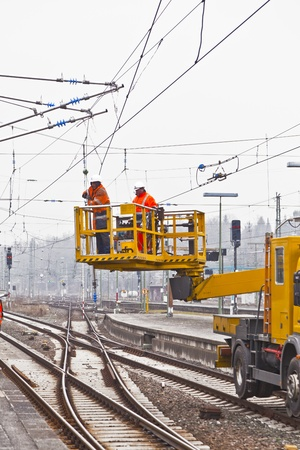 WIESBADEN, GERMANY. worker repair the catenary on February 2,2011 in Wiesbaden, Germany. The equipment is rented by Boehls, the leading rental company in Europe. Stock Photo - 12533375