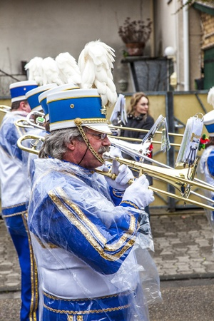 SCHWALBACH, GERMANY - FEBRUARY 27: The carnival  brass band  moves through the city on February 27, 2011 in Schwalbach, Germany. The Brass Band Rheinmain takes part as hosts at this annual event. Stock Photo - 12641068