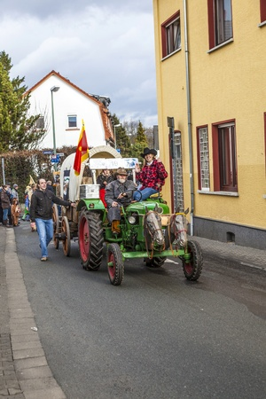 SCHWALBACH, GERMANY - BEBRUARY 27: the tractor with horse heads  moves through the city on February 27, 2011 in Schwalbach, Germany. The parade takes part every year. Stock Photo - 12676902