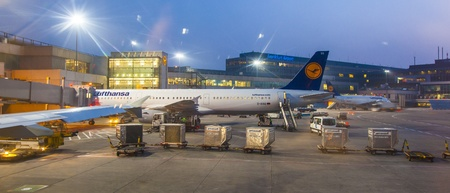 the back gate: FRANKFURT, GERMANY - MARCH 16: Lufthansa Flight at the gate for morning flight on August, 25, 2011 in Frankfurt, Germany. New Terminal A is under construction for airport enlargement. Editorial