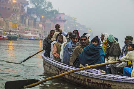 VARANASI - INDIA, JANUARY 1: Hindu people in a boat on river Ganga in the holy city of Varanasi. The holy ritual of washing is held every day in Varanasi, India, January 1,2012 .