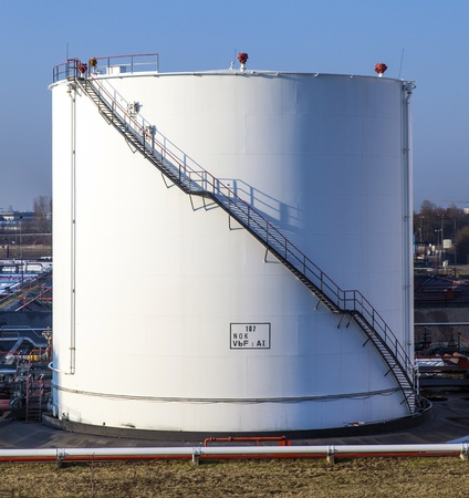 white tank in tank farm with blue sky