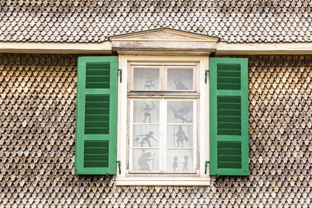 old house facade with open window photo