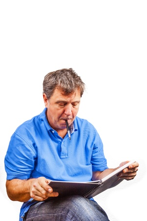 casual dressed man writing in a book photo
