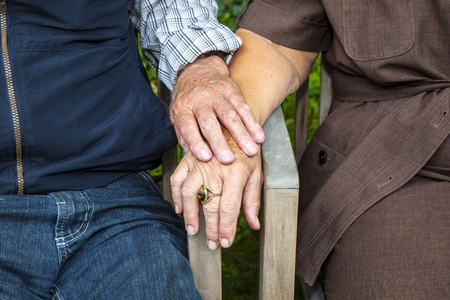 senior couple holding hands in love photo