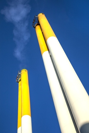 chimney with smoke and blue sky photo