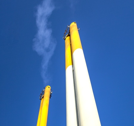 chimney with smoke and blue sky Stock Photo - 12983834