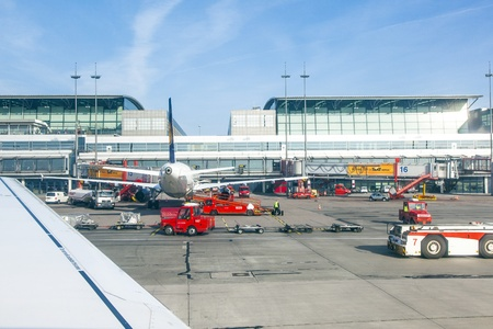 HAMBURG, GERMANY - MARCH 26: Aircraft at the gate in Terminal 2 on March 26,2011 in Hamburg, Germany. Terminal 2 was completed in 1993 and houses Lufthansa and other Star Alliance partners. Stock Photo - 12935924