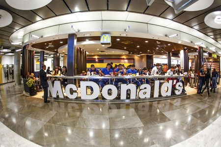 populous: MADRID, SPAIN - AUGUST 7 : Customers having their meals at McDonalds Madrid airport in Madrid, Spain on August 7, 2007. Madrid's metropolitan area is the fourth most populous area in Europe.