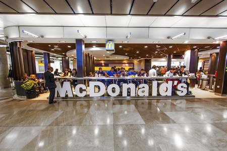mc: MADRID, SPAIN - AUGUST 7 : Customers having their meals at McDonalds Madrid airport in Madrid, Spain on August 7, 2007. Madrid's metropolitan area is the fourth most populous area in Europe.