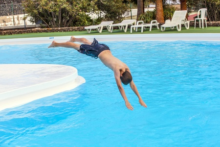 sky diving: boy has fun jumping in the pool