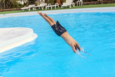 sky dive: boy has fun jumping in the pool