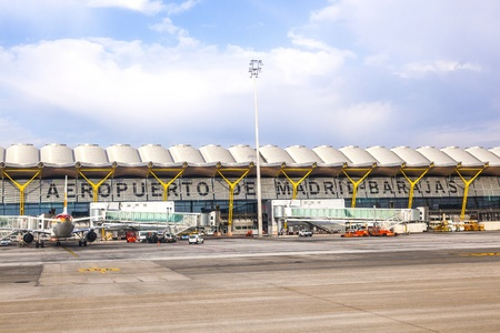 MADRID, SPAIN - APRIL 1: Aircrafts park at Terminal 4 at Barajay Airport  on April, 1 2012 in Madrid, Spain. In 2010, over 49.8 million passengers used Madrid-Barajas, making it the countrys largest airport.