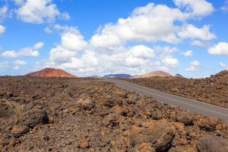 los hervideros: Road through lava rocks and volcanic mountains. Los Hervideros. Lanzarote Stock Photo
