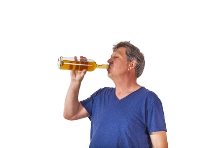 dependance: man drinking out of a glass