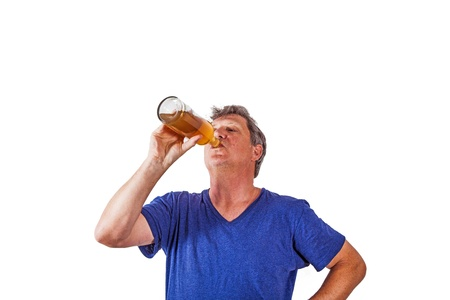 man drinking out of a glass photo