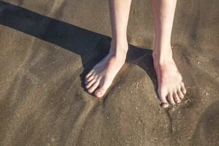 feet at the wet beach in harmonic pattern photo