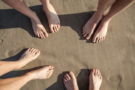boy feet: feet at the wet beach in harmonic pattern Stock Photo
