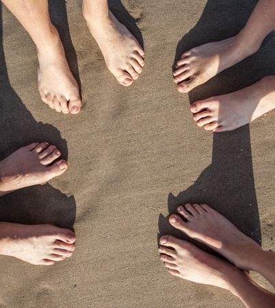 feet at the wet beach in harmonic pattern Stock Photo - 13448817
