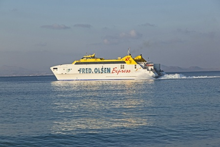 PLAYA BLANCA, SPAIN - APRIL 2: the ferry Bocayna Express from Fred Olsen on the ocean at April 2,2012 in Playa Blanca, Spain. Fred Olsen connects Lanzarote with Fuerteventura since 1962 with his line. Stock Photo - 13512062