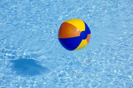 plastik: inflated plastic ball flying in the pool